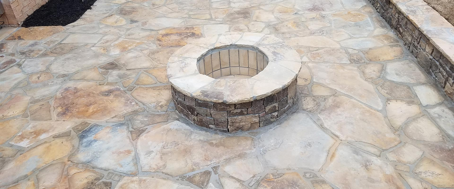 fllagstone patio with a firepit