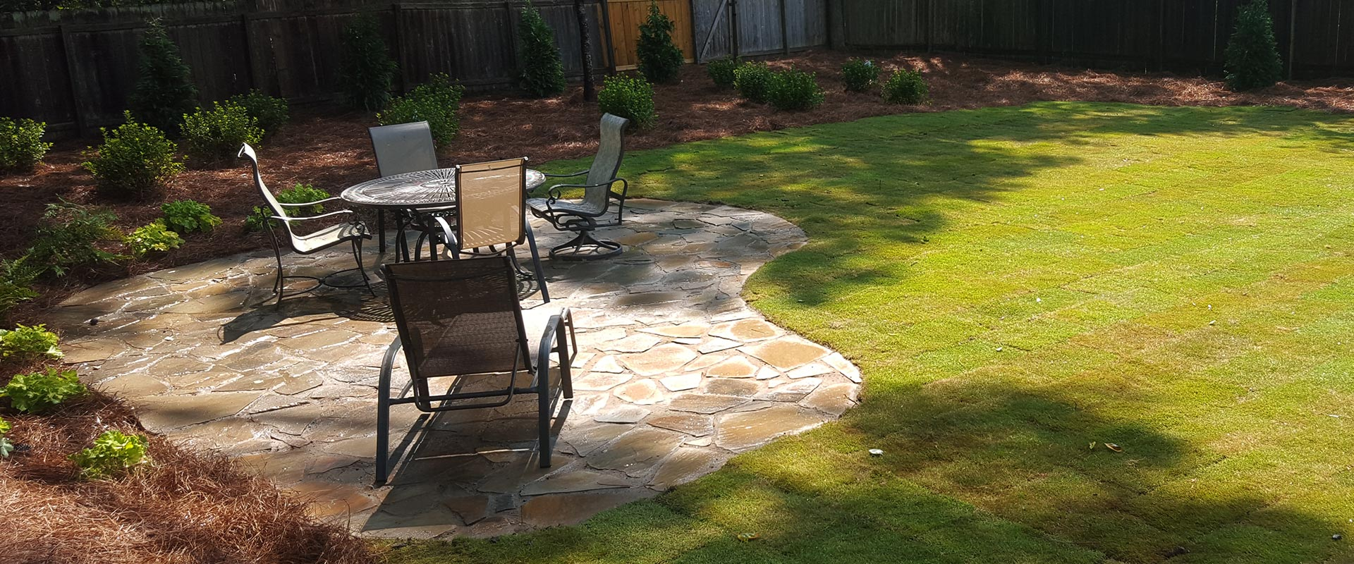 backyard flagstone patio with garden furniture