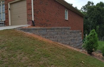 retaining wall next to a garage