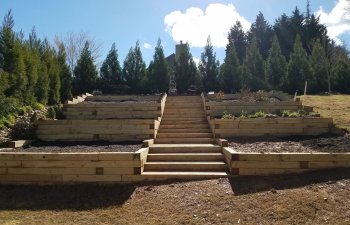 wooden retaining walls and steps