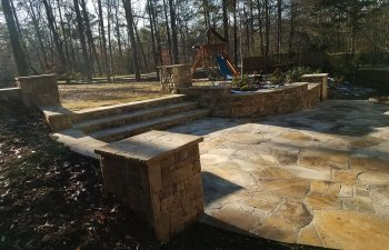 flagstone patio with steps to a garden