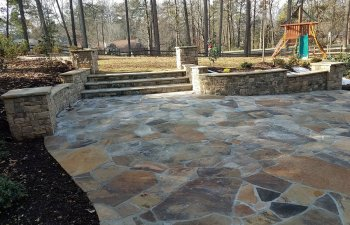 flagstone patio with steps to the garden