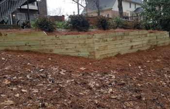 wooden retaining walls in a yard
