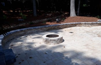 paver patio with a fire pit